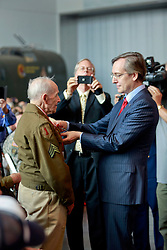 06 June 2014. The National WWII Museum, New Orleans, Lousiana. <br /> WWII veteran Sgt Orland Chaisson, 1st Infantry Division is honored with the French Legion of Honor medal by French Consul General Claude Brunet. <br /> Photo; Charlie Varley/varleypix.com