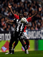 Photo: Jed Wee/Sportsbeat Images.<br /> Newcastle United v Barnsley. Carling Cup. 29/08/2007.<br /> <br /> Newcastle's Geremi (L) keeps Barnsley's Rohan Ricketts away from the ball.