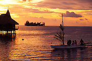 Outrigger Canoe at sunset, Bora Bora Lagoon Resort, French Polynesia (editorial use only)<br />