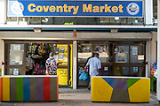 Sign for the famous Coventry Market in the UK City of Culture 2021 on 23rd June 2021 in Coventry, United Kingdom. The market is an indoor market with vendors for fruit, vegetables, meat, fish, artisanal items & secondhand goods. There has een a market on this site since 1958. The UK City of Culture is a designation given to a city in the United Kingdom for a period of one year. The aim of the initiative, which is administered by the Department for Digital, Culture, Media and Sport. Coventry is a city which is under a large scale and current regeneration.