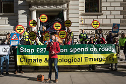 Caspar Hughes speaks outside the Treasury at a protest by XR Roads Rebellion activists against the UK government's £27.4bn roads programme on 21st October 2021 in London, United Kingdom. Environmental activists from groups including Extinction Rebellion argue that plans by the government to build new trunk roads are inconsistent with the UK's climate commitments and should be cancelled in the Autumn Spending Review.