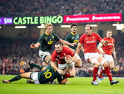 Ken Owens of Wales is tackled by Handre Pollard of South Africa<br /> <br /> Photographer Simon King/Replay Images<br /> <br /> Under Armour Series - Wales v South Africa - Saturday 24th November 2018 - Principality Stadium - Cardiff<br /> <br /> World Copyright © Replay Images . All rights reserved. info@replayimages.co.uk - http://replayimages.co.uk