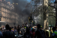 Smoke are coming from the clash of the protesters with the police.