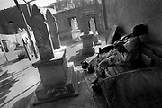Cairo, Egypt, The City of the Dead, 2000 - resident and tomb caretaker naps next to his home.