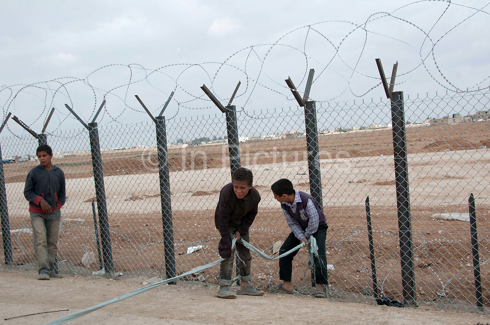 Jordan. Zaatari Camp for Syrian Refugees. Young boys with their version of a roadblock