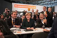 09 DEC 2014, KOELN/GERMANY:<br /> Vincent Kokert (L), CDU, Generalsekretaer der CDU MEcklenburg-Vorpommern, Angela Merkel (M), CDU, Bundeskanzlerin, und Lorenz Caffier (R), CDU Landesvorsitzender und Innenminister Mecklenburg-Vorpommern, vor der Bekanntgabe des Wahlergebnisses ihrer Wiederwahl zur Bundesvorsitzenden der CDU, CDU Bundesparteitag, Messe Koeln<br /> IMAGE: 20141209-01-084<br /> KEYWORDS: Wahl, Wahlergebnis, Party Congress