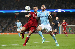 Liverpool's Dejan Lovren and Manchester City's Gabriel Jesus battle for the ball during the UEFA Champions League, Quarter Final at the Etihad Stadium, Manchester.