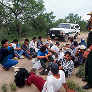 A group of undocumented migrants are detained after crossing the Rio Grande River into Eagle Pass, Texas. The river is the international boundary between Piedras Negras, MX and Eagle Pass and is easily crossed, making the small Texas town a hot-spot for illegal crossings. Please contact Todd Bigelow directly with your licensing requests.