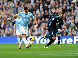 Manchester City's Sergio Aguero attempts to score a chip - Photo mandatory by-line: Dougie Allward/JMP - Tel: Mobile: 07966 386802 24/11/2013 - SPORT - Football - Manchester - Etihad Stadium - Manchester City v Tottenham Hotspur - Barclays Premier League