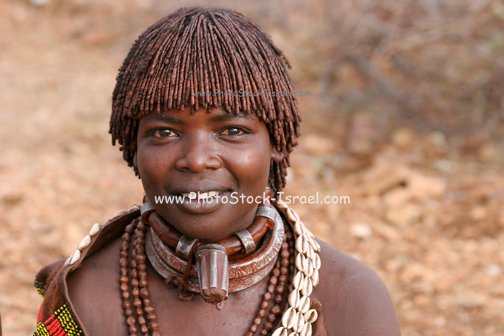 Portrait of a Hamer Tribeswoman. The hair is coated with ochre mud and animal fat. Photographed in the Omo River Valley, Ethiopia