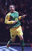 Harry Kewell celebrates after scoring the 2nd goal for Australia. England v Australia, Upton Park, 12/02/2003. Credit: Colorsport / Matthew Impey