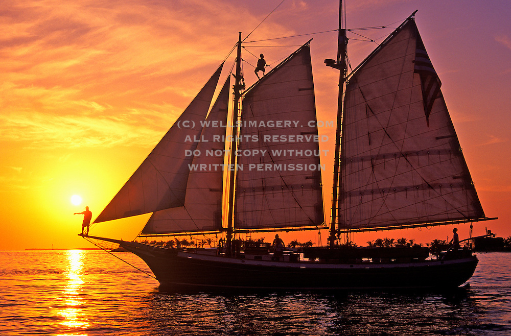 Image of a sailboat at sunset off Mallory Square at Key West, Florida by Randy Wells