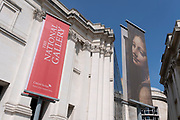 A banner promoting the current exihibition of Italian Baroque art by Artemisia Gentileschi at the National Gallery in Trafalgar Square on Covid 'Freedom Day'. This date is what Prime Minister Boris Johnson's UK government has set as the end of strict Covid pandemic social distancing conditions with the end of mandatory face coverings in shops and public transport, on 19th July 2021, in London, England.