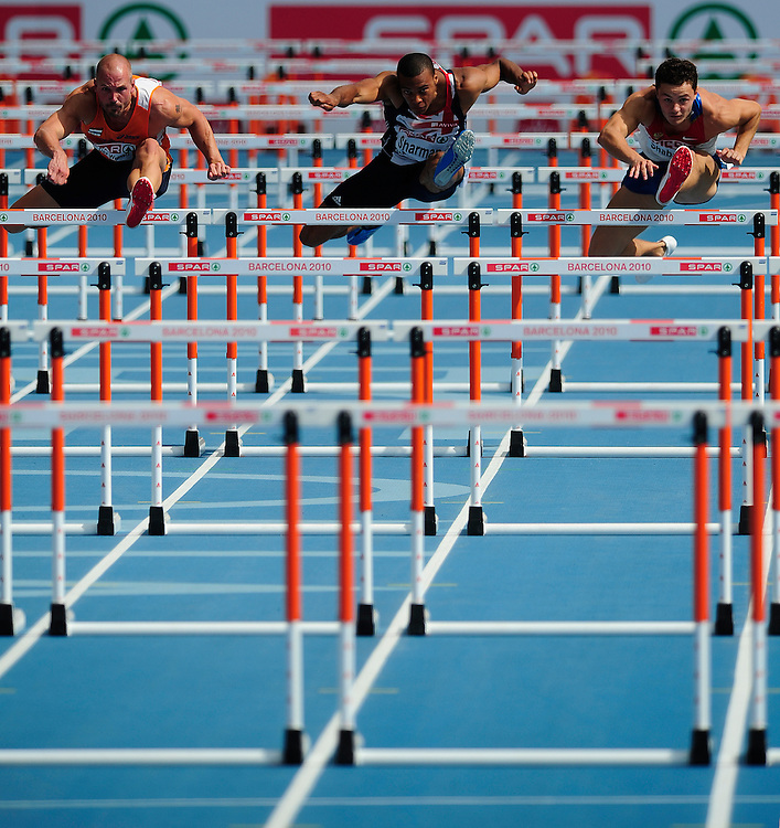 From left, Netherlands' Marcel Van Der Westen, Britain's William Sharman and Russia's Konstantin Shabanov competes in the first round heat 2 of the men's 110m hurdles at the 2010 European Athletics Championships at the Olympic Stadium in Barcelona on July 29, 2010. .