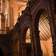 Image of a section of the Plaza de Espana illuminated at night. Seville, Spain