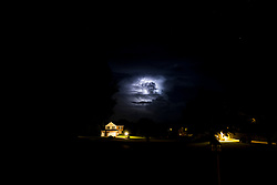 Lightning lights up the early night skies as thunderstorms pass by in Central Illinois.