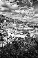 Black and white view of Monte Carlo, the Port of Hercules, and the Mediterranean Sea taken from the Princes Palace, Monaco France (Vertical).