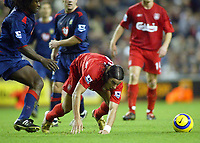 14/12/2004 - FA Barclays Premiership - Liverpool v Portsmouth - Anfield, Liverpool<br /> Liverpool's Milan Baros struggles to get to the ball pursued by Portsmouth's Linvoy Primus<br /> Photo:Jed Leicester/Digitalsport