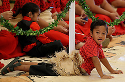 A child lies on the floor as people wait for the arrival of the Duke and Duchess of Sussex, ahead of a meeting with Tongan prime minister Akilisi Pohiva and his cabinet on the second day of the royal couple's visit to Tonga.