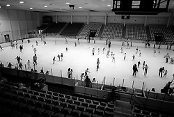Ice skaters glide around the rink at Mennen Arena in Morris Plains, N.J., Thursday, Feb. 13, 1986. (D. Ross Cameron/North Jersey Advance)