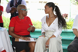 Singer Rihanna (right) answers questions in preparation of an live HIV test, at the 'Man Aware' event held by the Barbados National HIV/AIDS Commission in Bridgetown, Barbados, attended also by Prince Harry during his tour of the Caribbean.