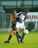 Photograph: Scott Heavey.<br />Bristol Rovers v Wolverhampton Wanderers.<br />14/7/2003.<br />David Gilroy holds off Wolves defender Mark Clyde during this friendly match at the home of Bristol Rovers, The Memorial Ground.
