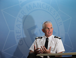 "© Licensed to London News Pictures . 13/10/2014 . Manchester , UK . SIR PETER FAHY , Chief Constable of Greater Manchester Police at a press conference at the force's HQ ahead of police "" Twitter Day "" , during which they'll live tweet every single incident they respond to , for 24 hours . The event , which starts at 5am tomorrow ( Thursday 14th October 2014 ) , will utilise the hashtag gmp24 . Photo credit : Joel Goodman/LNP"