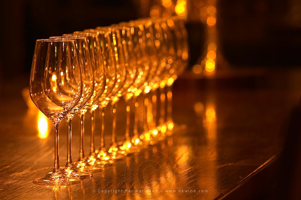 A straight row of wine tasting glasses lined up on a dark wooden table in golden light Ulriksdal Ulriksdals Wärdshus Värdshus Wardshus Vardshus Restaurant, Stockholm, Sweden, Sverige, Europe