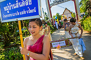 31 OCTOBER 2012 - YARANG, PATTANI, THAILAND: Villagers leave Wat Kohwai for their Ok Phansa procession to Yala. Ok Phansa marks the end of the Buddhist 'Lent' and falls on the full moon of the eleventh lunar month (October). It's a day of joyful celebration and merit-making. For the members of Wat Kohwai, in Yarang District of Pattani, it was a even more special because it was the first time in eight years they've been able to celebrate Ok Phansa. The Buddhist community is surrounded by Muslim villages and it's been too dangerous to hold the boisterous celebration because of the Muslim insurgency that is very active in this area. This the year the Thai army sent a special group of soldiers to secure the village and accompany the villagers on their procession to Yala, a city  about 20 miles away.   PHOTO BY JACK KURTZ