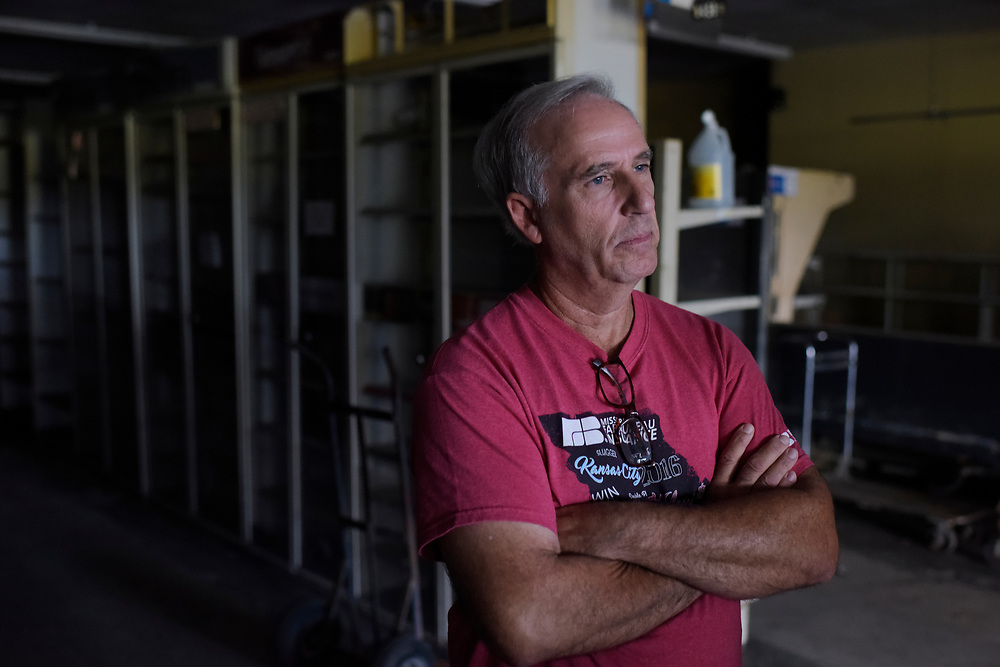 """Jim Snoddy gazes out of his store outside of Boonville. When asked if the store was going to reopen, he took a long look around the store before settling his eyes somewhere outside, a tired """"I don't know"""" was his reply. The cost to repair the store would be upwards of 150,000, and without assistance from FEMA, the likelihood of the Snoddy brothers returning behind the counter was low."""