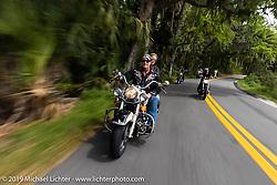 Jay Allen riding his Shovelhead through Tomoka State Park during Daytona Bike Week. FL. USA. Sunday March 18, 2018. Photography ©2018 Michael Lichter.