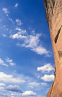 "Man Rock climbing.  Smith Rock State Park, Oregon, USA.  Climb Rating 5.7, ""Spiderman"".<br />"