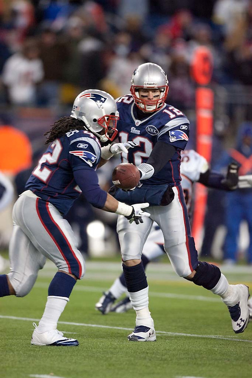 Foxborough, MA 01/14/2012.Patriots quarterback Tom Brady hands the ball off to running back BenJarvus Green-Ellis in the second half of  Saturday's AFC Divisional game between the New England Patriots and the Denver Broncos..Wicked Local Photo by Alex Jones