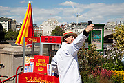 Spring community activities on The Southbank, London. British seaside in central London, on a 70-metre beach that appears on Queen's Walk for the duration of the Festival of Britain celebrations. Popcorn seller takes his own photo.