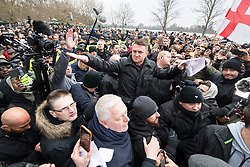 """© Licensed to London News Pictures . 18/03/2018 . London , UK . TOMMY ROBINSON (centre) delivers his speech to the crowd . 1000s including supports of alt-right groups such as Generation Identity and the Football Lads Alliance , at Speakers' Corner in Hyde Park where Tommy Robinson reads a speech by Generation Identity campaigner Martin Sellner . Along with Brittany Pettibone , Sellner was due to deliver the speech last week but the pair were arrested and detained by police when they arrived in the UK , forcing them to cancel an appearance at a UKIP """" Young Independence """" youth event , which in turn was reportedly cancelled amid security concerns . Photo credit: Joel Goodman/LNP"""