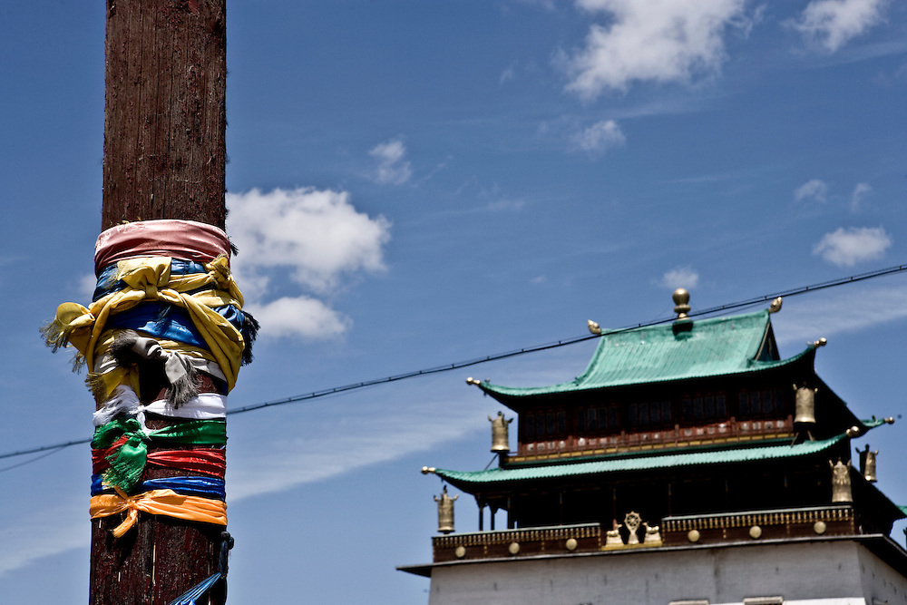 Holy pole with parayer scarves in Mongolian monastary.