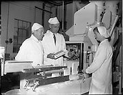26/10/1959<br /> 10/26/1959<br /> 26 October 1959<br /> Swiss Charge d'Affairs visit to Goodbody's Factory, Dun Laoghaire, (Albright and Wilson Ireland).  Image shows the party on a tour of the factory where soda bread mix is being packaged.Wholemeal, Four, Bread, Baking,