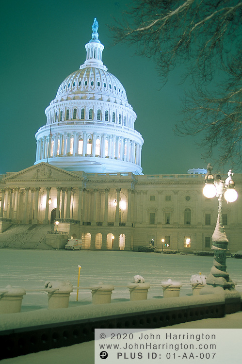The US Capitol as seen at night after a light snow.