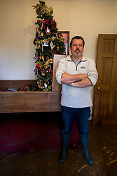© Licensed to London News Pictures. 29/12/2015. York, UK. MARTIN SHOOBRIDGE, a resident on Huntingdon Road in York for 10 years, stands next to his christmas tree as he looks at damage to his home following heavy flooding. Further rainfall is expected over coming days as Storm Frank approaches the east coast of the country. Photo credit: Ben Cawthra/LNP