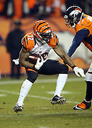 Cincinnati Bengals running back Jeremy Hill (32) jumps as he makes a cut while running the ball during the 2015 NFL week 16 regular season football game against the Denver Broncos on Monday, Dec. 28, 2015 in Denver. The Broncos won the game in overtime 20-17. (©Paul Anthony Spinelli)