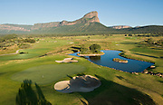 The world's toughest golf hole where players have to tee off from a MOUNTAIN onto the green 400 yards below (and have to be flown there by helicopter)<br /> <br /> Forget your local pitch and putt, this mammoth Par 3 is one of golf's greatest challenges - and that's just getting to the tee!<br /> The Extreme 19th is the world's longest par 3, measuring 391 yards, and challengers can only access the tee by helicopter.<br /> Sat atop South Africa's Hanglip Mountain, at 400 metres tall it is also the globe's highest hole, meaning it takes almost 30 seconds for any tee shot to reach the Africa-shaped green below.<br /> Part of the Legend Golf Resort, situated in South Africa's Waterberg mountain range, the course has been designed by 18 of the globes top players, including Justin Rose and Retief Goosen.<br /> Irishman Padraig Harrington, the 2008 Open Champion, was the first person to make par on the hole but has since been joined by Morgan Freeman and many more.<br /> As there are no cameras or GPS used to track the flight of the golf ball, a spotter is employed to try and locate where it lands. <br /> ©Exclusivepix