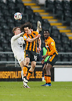 Oxford United's Josh Ruffels hooks the ball over his head under pressure from Hull City's George Honeyman<br /> <br /> Photographer Lee Parker/CameraSport<br /> <br /> The EFL Sky Bet League One - Hull City v Oxford United - Saturday 13th March 2021 - KCOM Stadium - Kingston upon Hull<br /> <br /> World Copyright © 2021 CameraSport. All rights reserved. 43 Linden Ave. Countesthorpe. Leicester. England. LE8 5PG - Tel: +44 (0) 116 277 4147 - admin@camerasport.com - www.camerasport.com