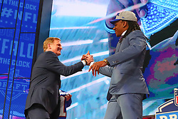April 26, 2018 - Arlington, TX, U.S. - ARLINGTON, TX - APRIL 26:  Tremaine Edmunds shakes hands with Commissioner Roger Goodell  after being chosen by the Buffalo Bills with the 16th pick during the first round at the 2018 NFL Draft at AT&T Statium on April 26, 2018 at AT&T Stadium in Arlington Texas.  (Photo by Rich Graessle/Icon Sportswire) (Credit Image: © Rich Graessle/Icon SMI via ZUMA Press)