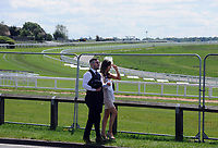Horse Racing - Epsom Festival - Derby Day - Epsom Downs<br /> <br /> A couple walk along the fencing, surrounding the course that has closed off viewing to the public<br /> <br /> Credit : COLORSPORT/ANDREW COWIE