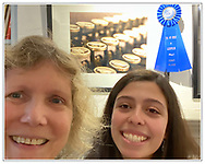 Manhasset, New York, U.S., February 1, 2020. First Prize winners for (l-r) adult and for student categories stand in front of Student First Prize photograph of vintage typewriter, at Reception for The Art Guild exhibition, held at Elderfields Preserve.