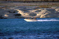 AZ, Arizona Lake Powell, near Grand Canyon National Park, scenic, power boat with Utah border in background, sunset .Photo Copyright: Lee Foster, lee@fostertravel.com, www.fostertravel.com, (510) 549-2202.Image: azlkpo219