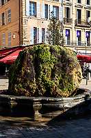 Fontaine d'Eau Chaude is also called Mossy Fountain or Fontaine – the first fountain built on the Cours Mirabeau, this mid-17th century Fountain of Hot Water takes its name from the thermal water sourced from the hot springs of Bagniers. For many years local housewives were forbidden to wash their clothes here as the warm waters were better for doing laundry, though the waters were used to clean the area.  The fountain's nickname fontaine moussue refers to the moss that covers it.