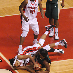 Jan 31, 2009; Piscataway, NJ, USA; Rutgers guard Brittany Ray (35) battles for a loose ball with South Florida center Brittany Denson (32) during the second half of South Florida's 59-56 victory over Rutgers in NCAA women's college basketball at the Louis Brown Athletic Center