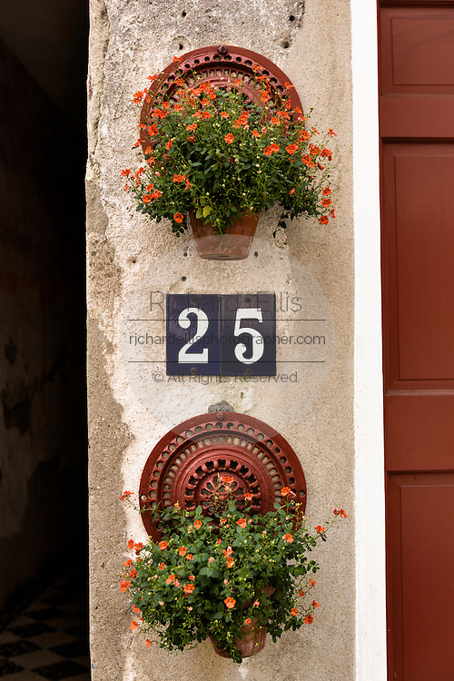 Flowers blooming in window boxes along Queen Street in historic Charleston, SC.