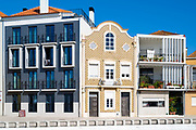 Traditional and modern architecture contrast in canal side property at Aveiro, Portugal